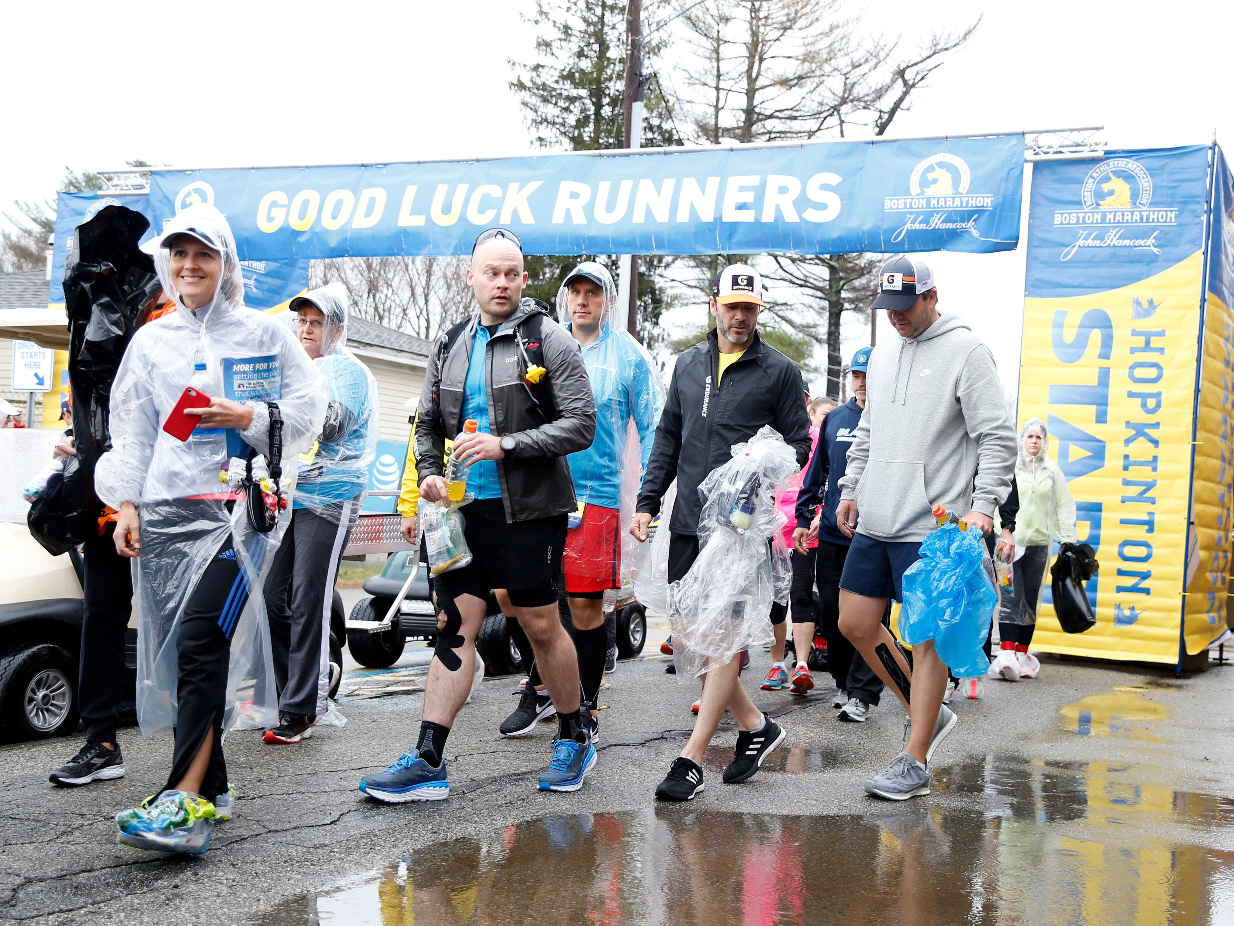 NASCAR driver Jimmie Johnson (second from right) prepares for the 2019 Boston Marathon.