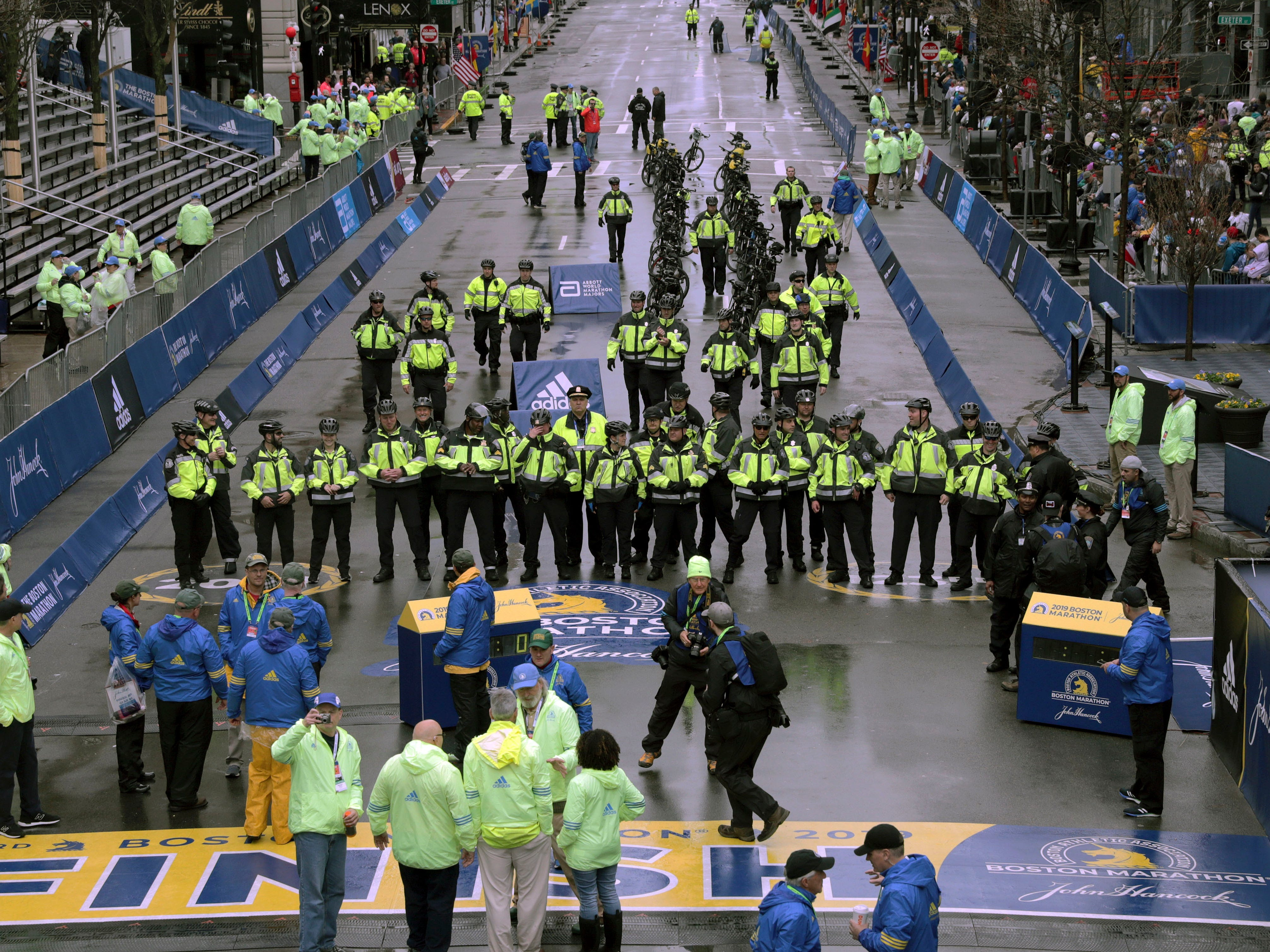 Police officers at the finish line before the start of the 123rd Boston Marathon.