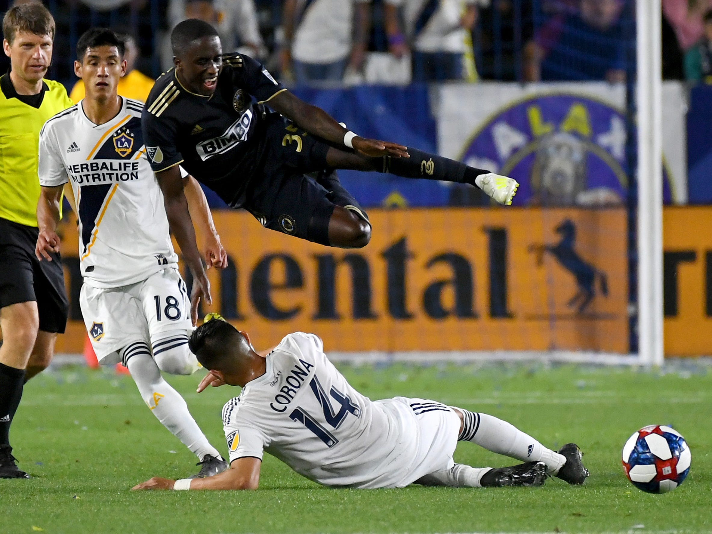 April 13: Philadelphia Union midfielder Jamiro Monteiro (35) jumps over Los Angeles Galaxy midfielder Joe Corona (14) to avoid a collision in the first half of the game at StubHub Center. The Galaxy won the game, 2-0.