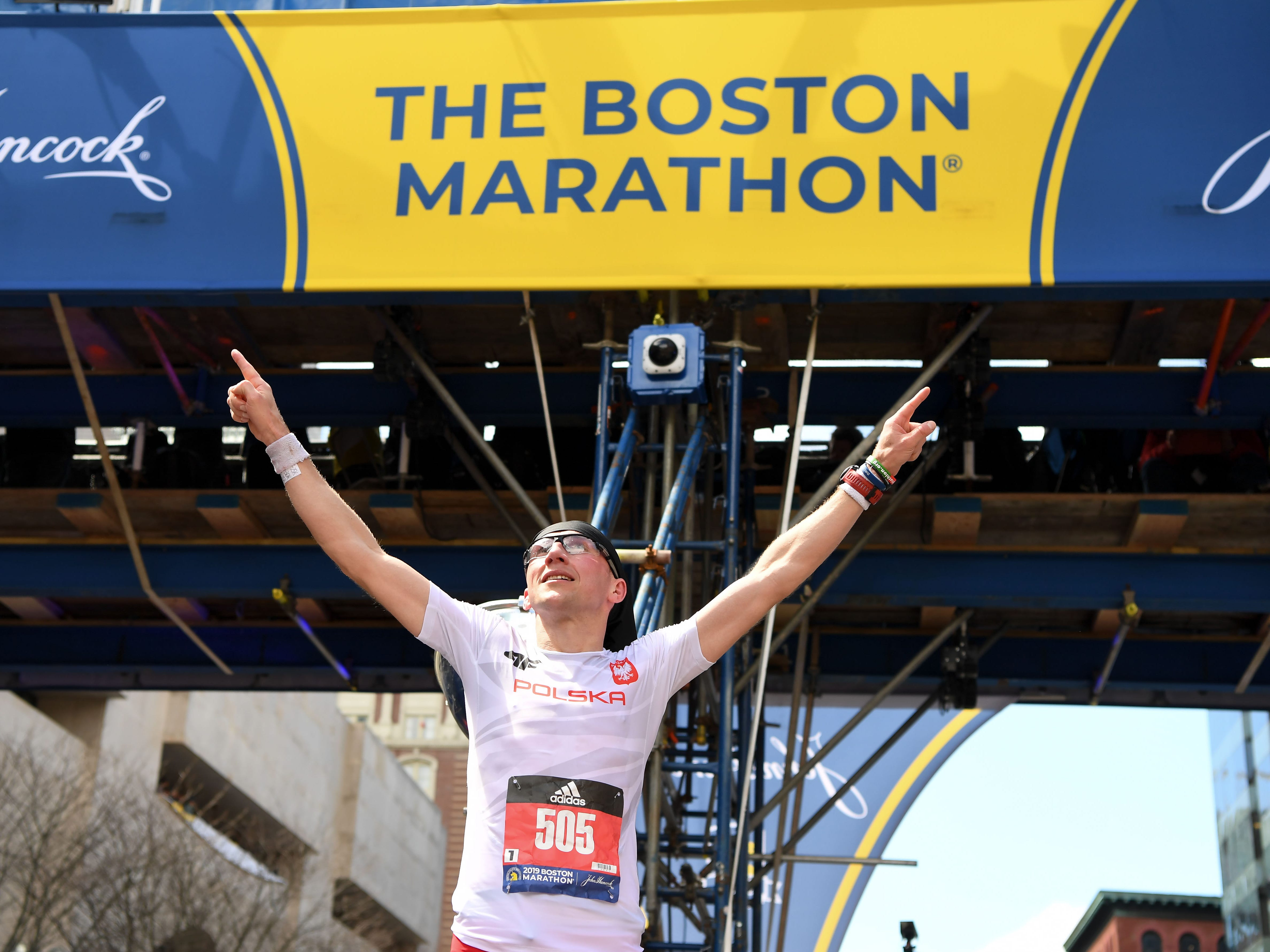 Marcin Soszka reacts at the 2019 Boston Marathon.