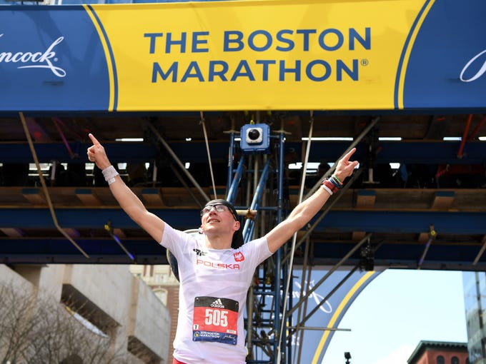 Marcin Soszka reacts at the 2019 Boston Marathon.