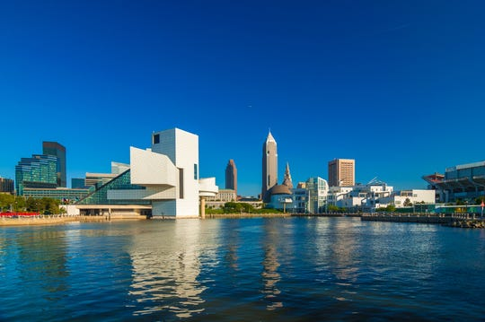 Cleveland downtown waterfront skyline with the Rock and Roll Hall of Fame museum and the Great Lakes Science Center.