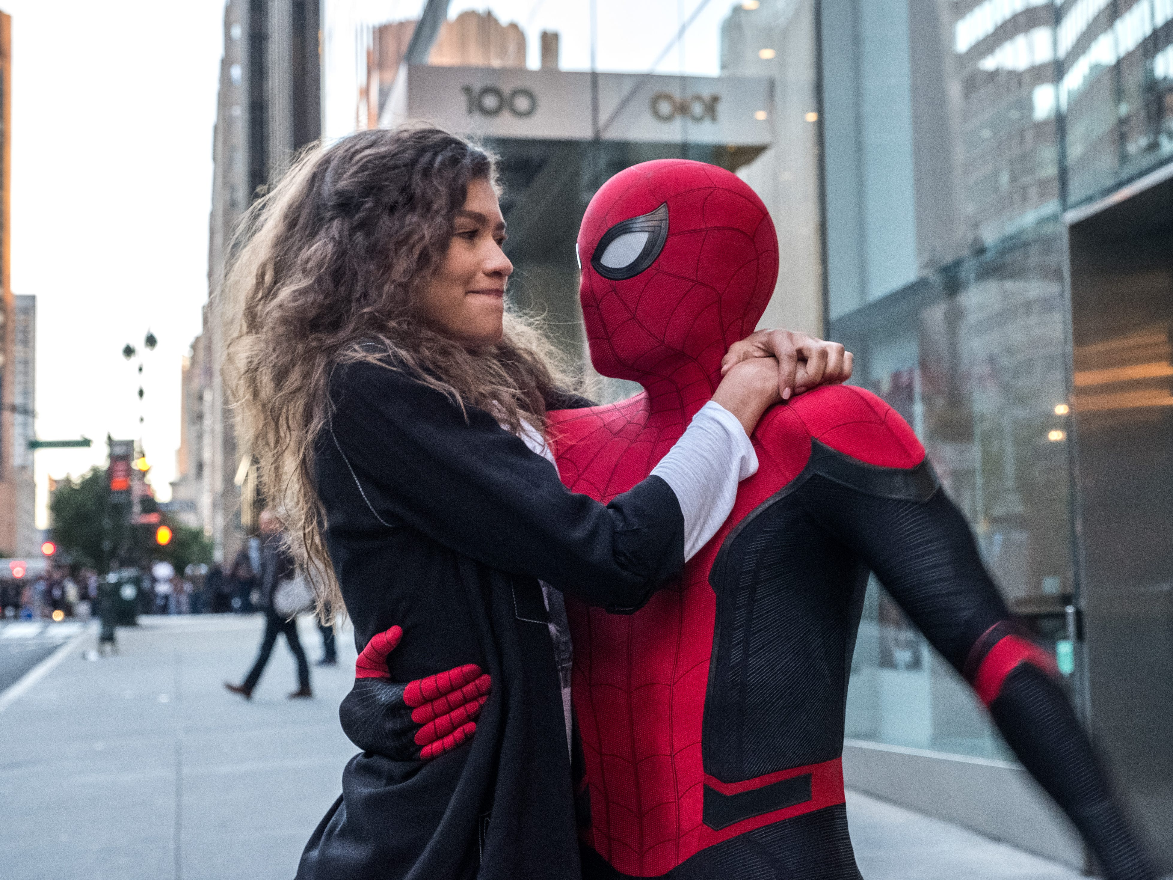 "M.J.  (Zendaya) catches a ride from Spider-Man (Tom Holland) in ""Spider-Man: Far From Home."""