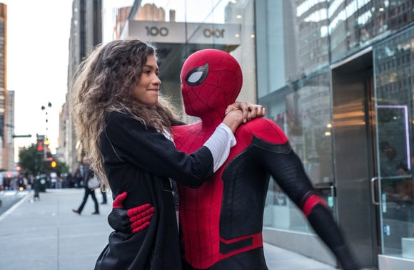 "MJ (Zendaya) catches a ride from Spider-Man (Tom Holland) in ""Spider-Man: Far From Home."""