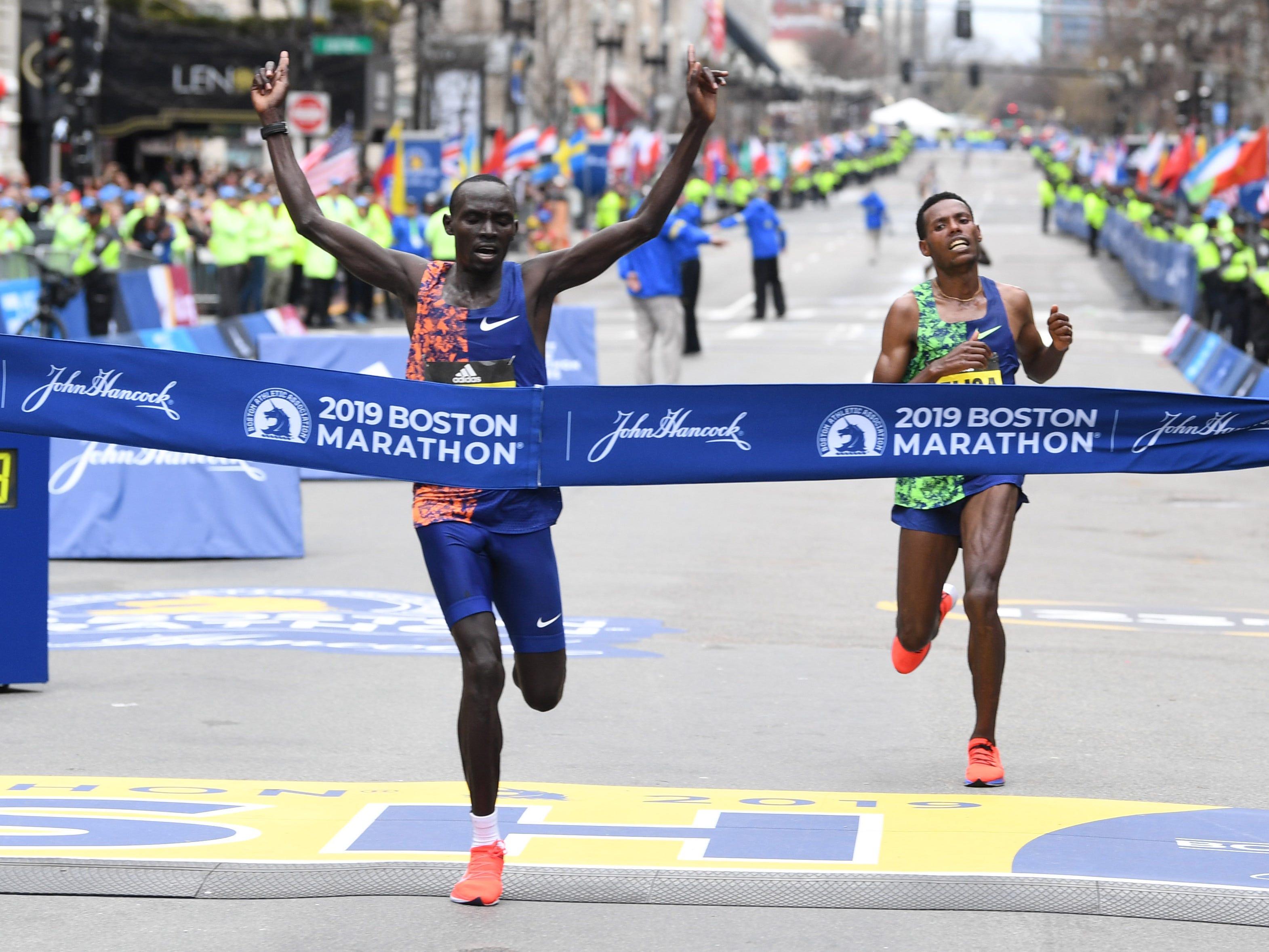 Lawrence Cherono (KEN) crosses the finish line to win the 2019 Boston Marathon. Lelisa Desisa (ETH) finishes second.