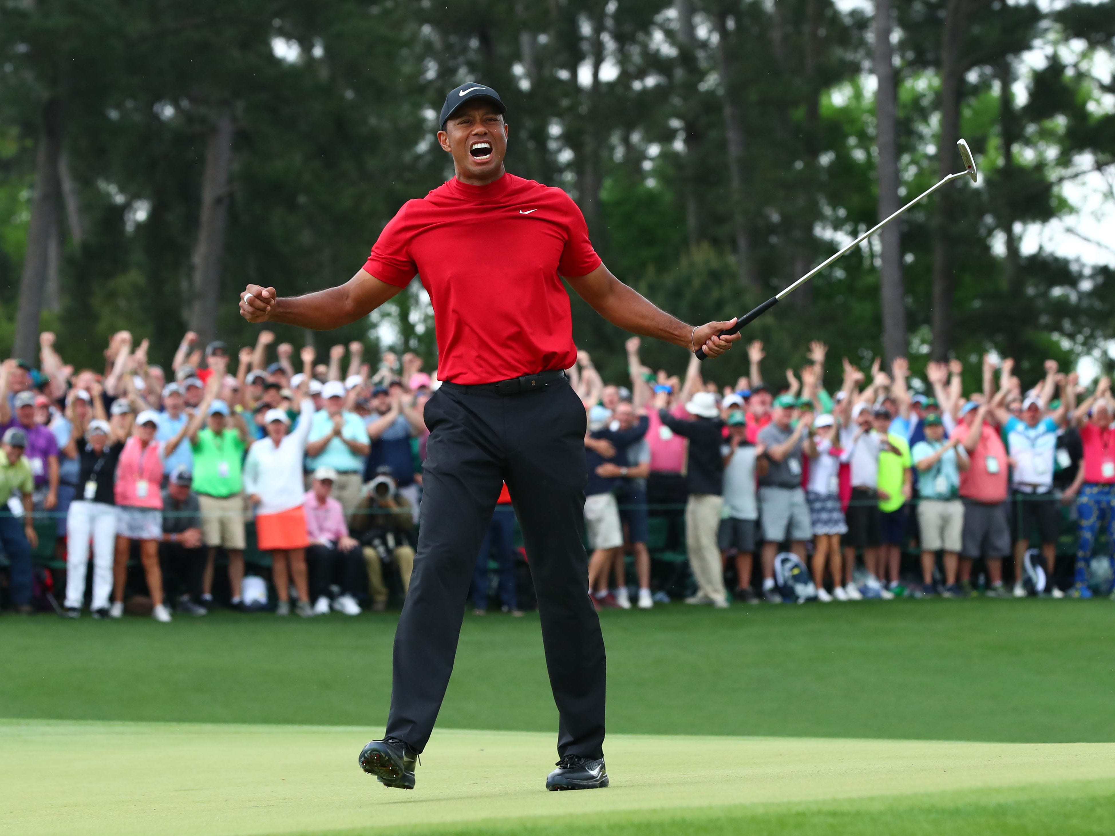 Tiger Woods celebrates.