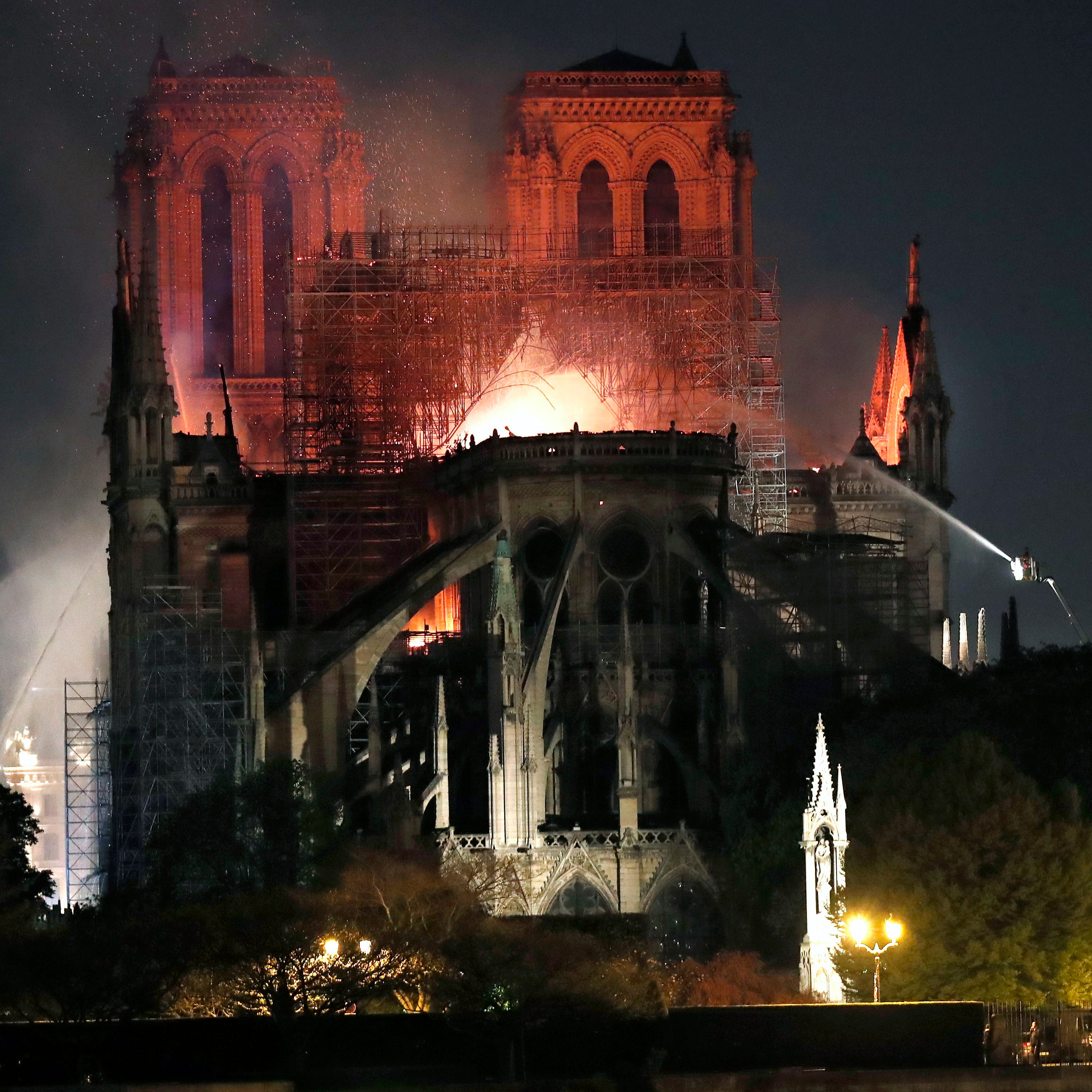 Flames burn the roof of the Notre Dame Cathedral in Paris on April 15, 2019.