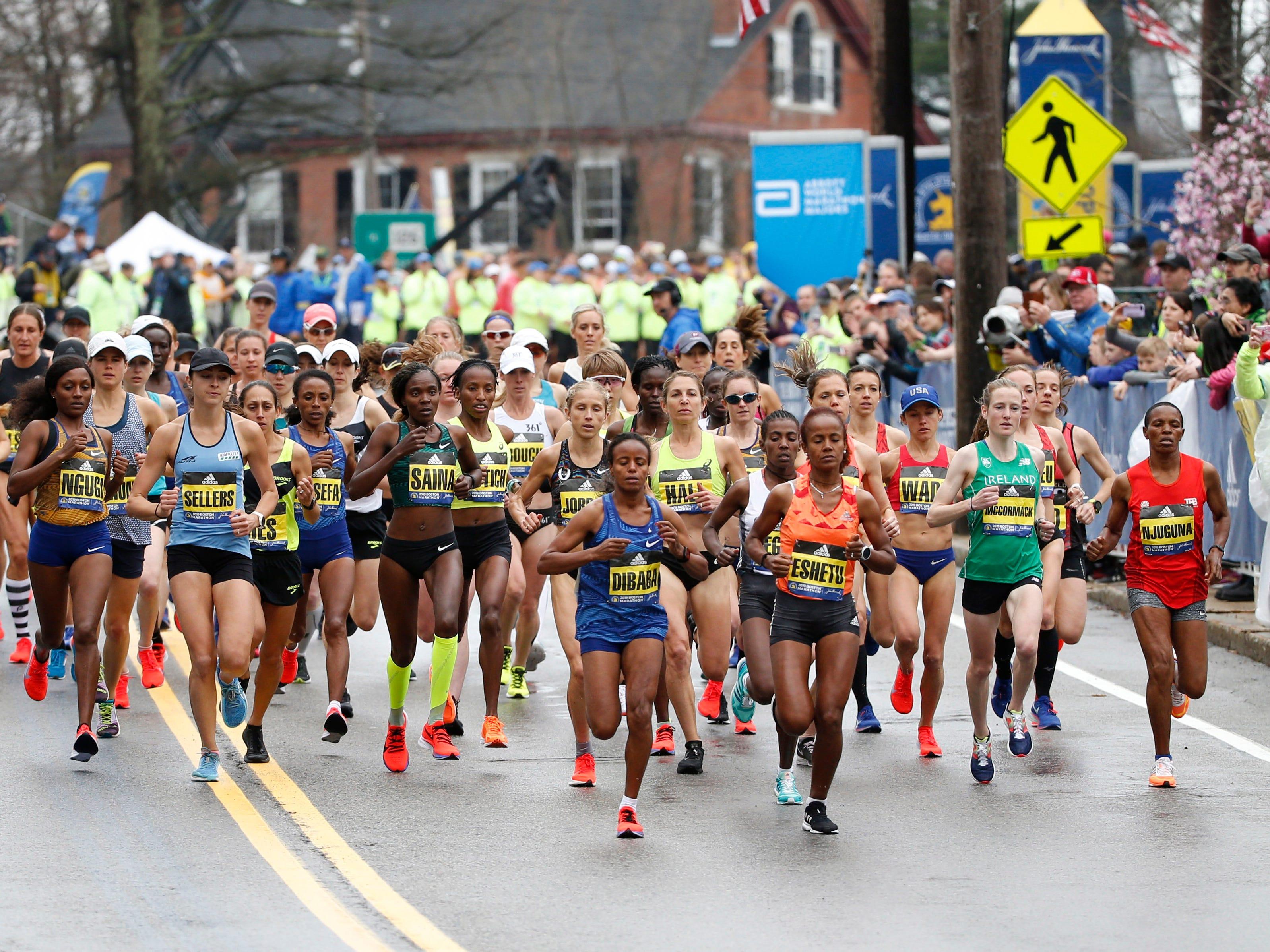 Mare Dibaba and Biruktayit Eshetu lead the pack at the elite women's start during the 2019 Boston Marathon.
