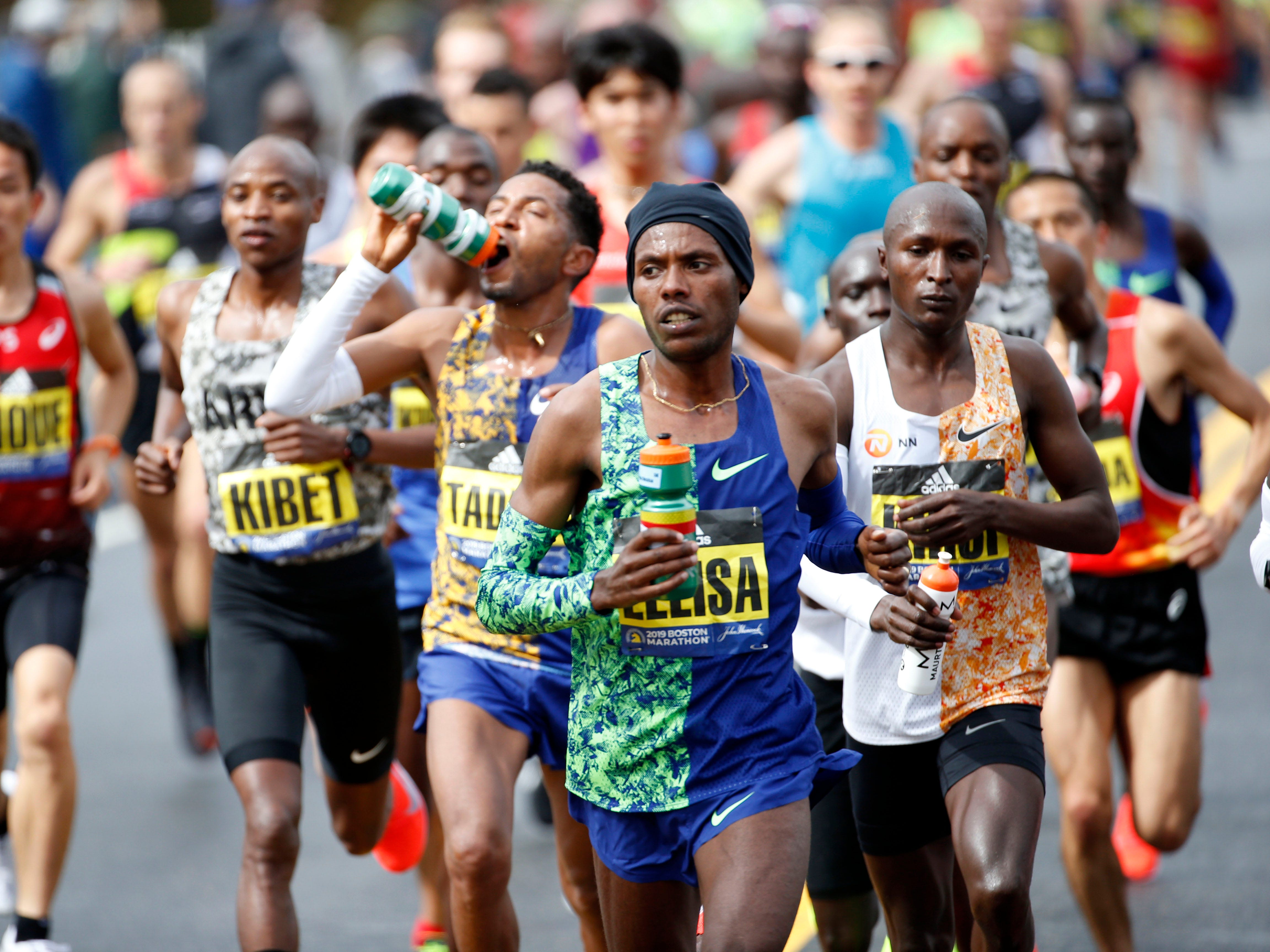 Lelisa Desisa out in front in the elite men's group during the 2019 Boston Marathon.