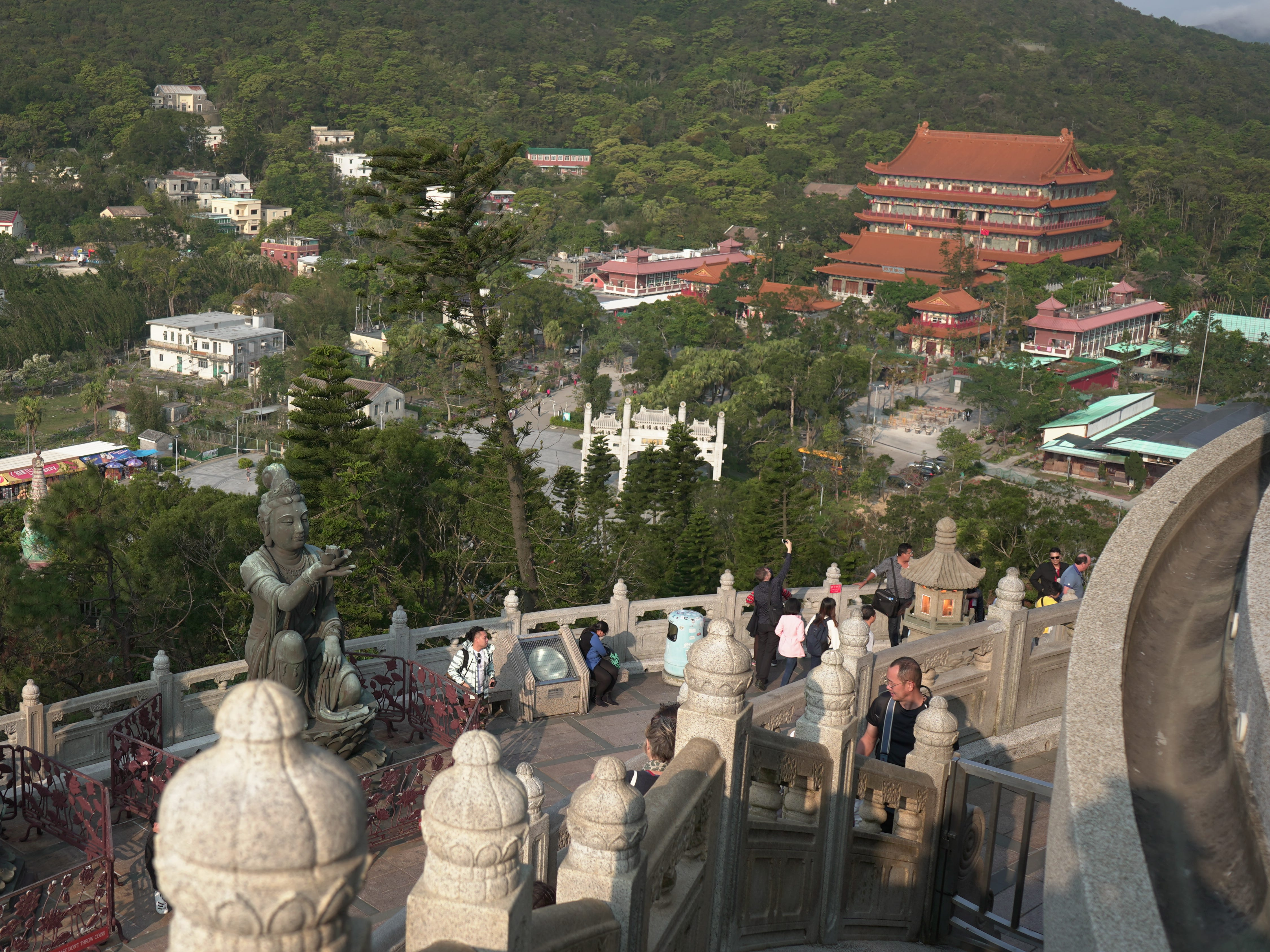 The devas surrounding the Tian Tan Buddha, with the Po Lin Monastery in the distance.
