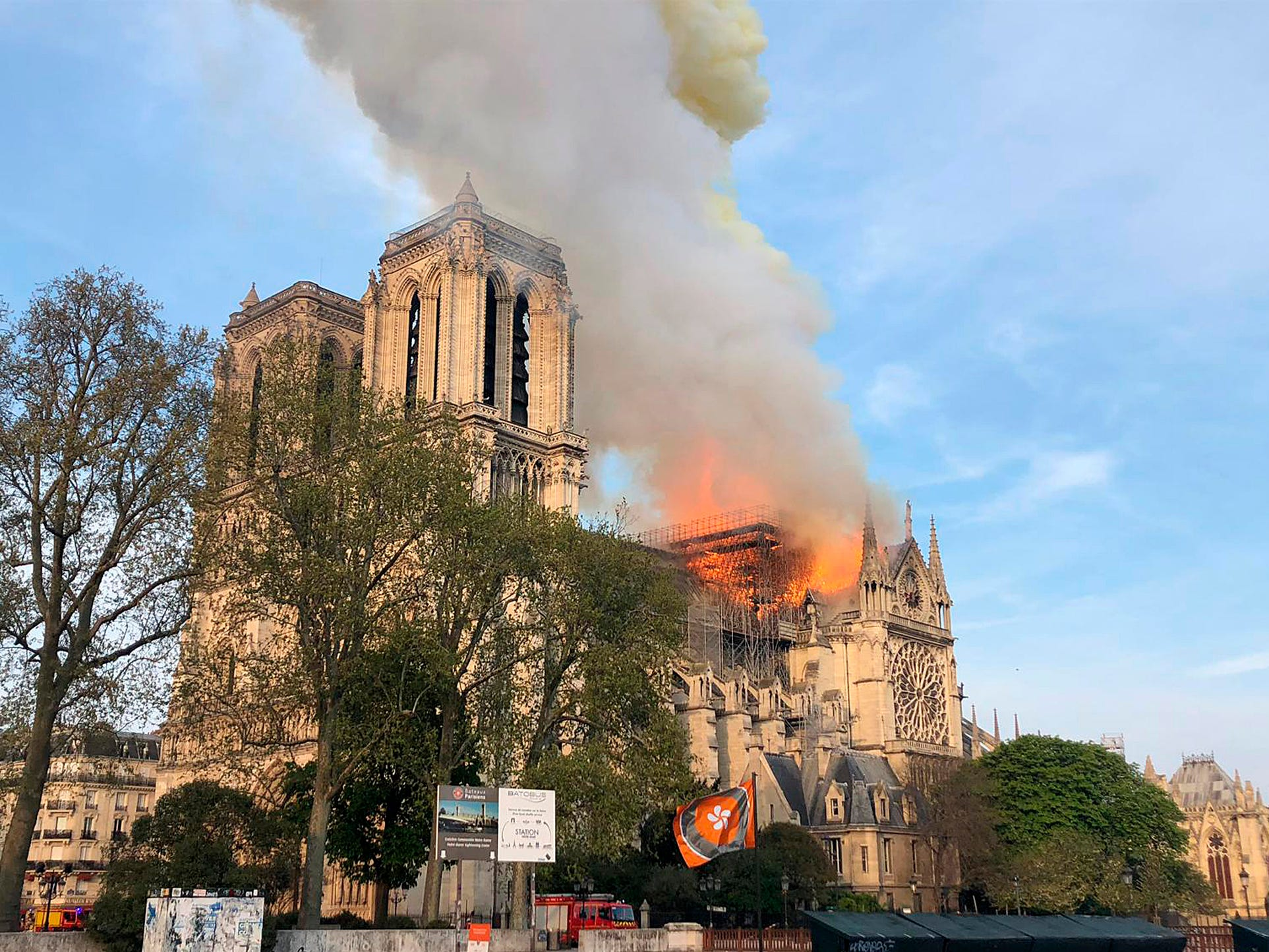 Notre Dame Cathedral is burning in Paris on Monday, April 15, 2019. Massive plumes of yellow brown smoke is filling the air above Notre Dame Cathedral and ash is falling on tourists and others around the island that marks the center of Paris.