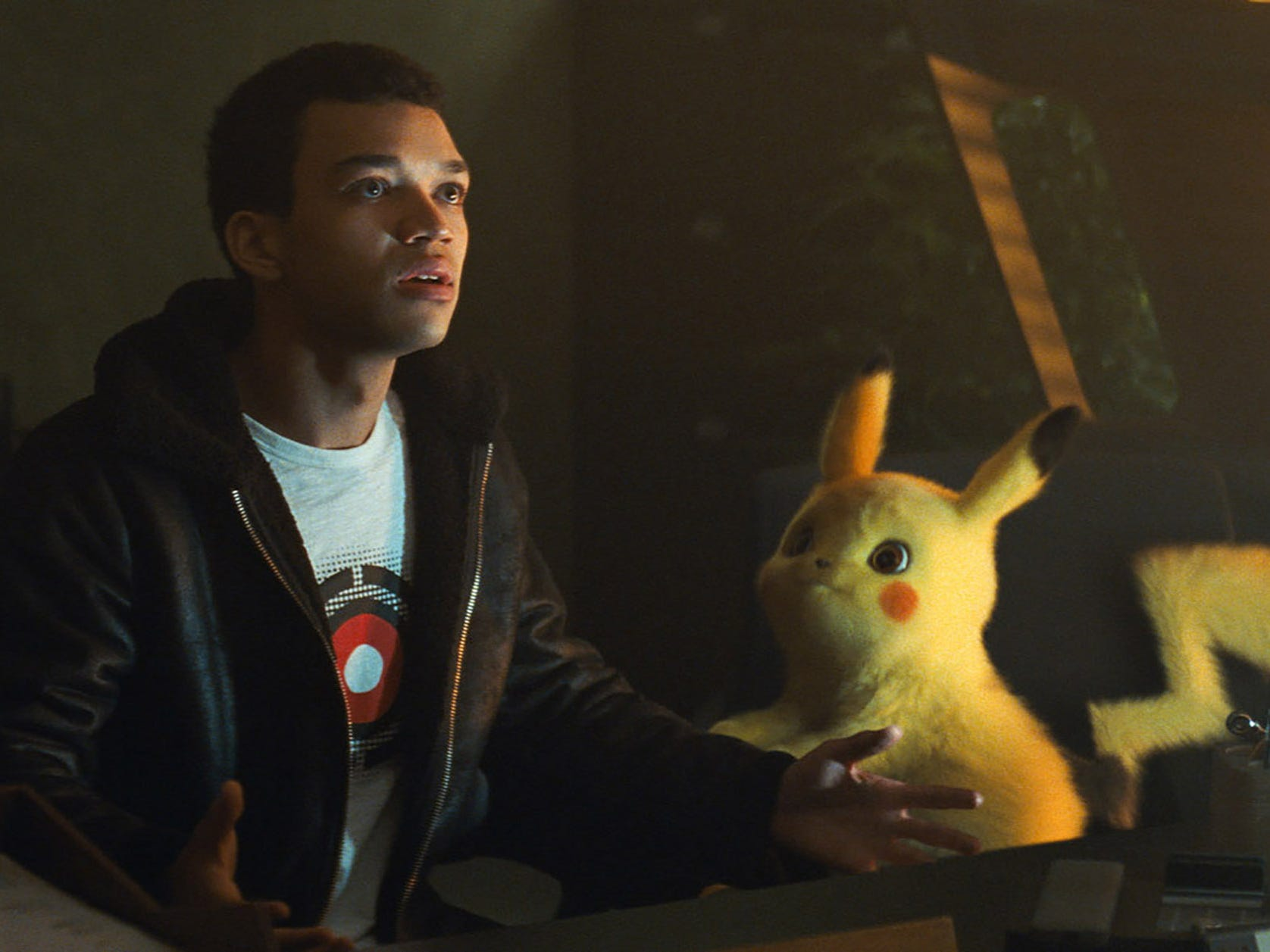 "Tim (Justice Smith) teams with cute sleuth Pikachu (voiced by Ryan Reynolds) to find his missing dad in the comedy ""Pokemon: Detective Pikachu."" (May 10)"