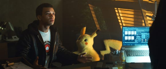 Ryan Reynolds voices Pikachu, right, alongside Justice Smith's Tim.