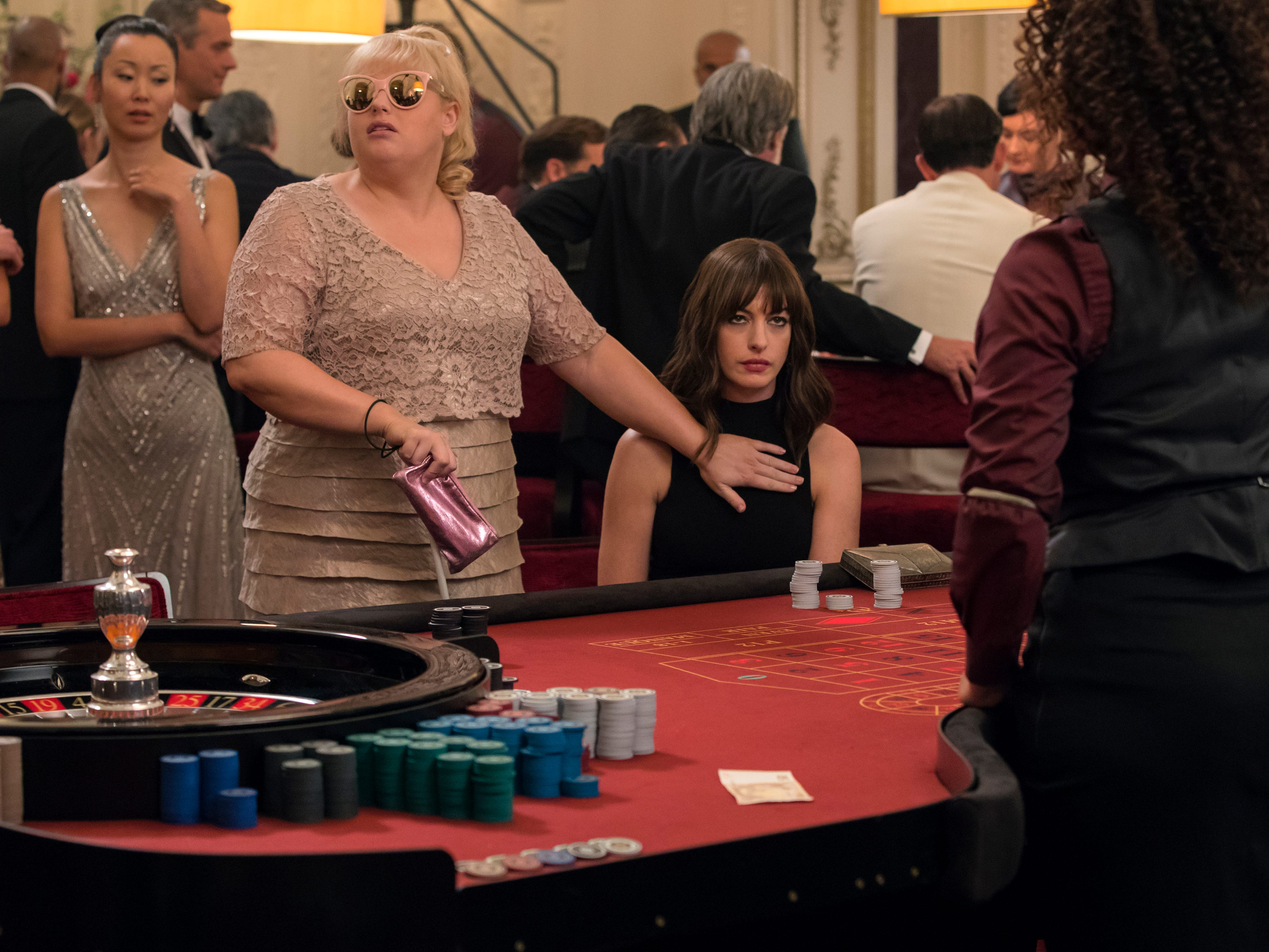 "Rebel Wilson (left) and Anne Hathaway star as a couple of scam artists seeking revenge on men who've wronged them in the comedy ""The Hustle."" (May 10)"
