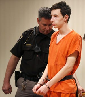 Alexander M. Kraus, 17, is shown during his initial appearance in April. Kraus is accused of two counts of first-degree intentional homicide of his grandparents, Dennis L. Kraus, 74, and Letha G. Kraus, 73.