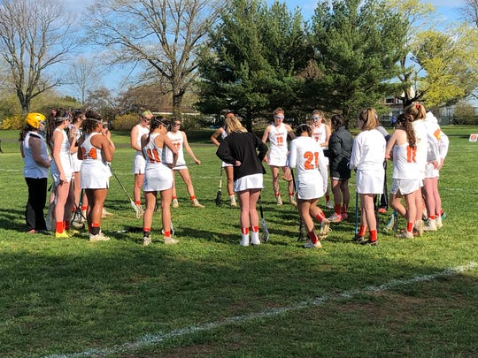 Trinity Hall discusses strategy during a timeout on April 16, 2019 against St. Rose at the Dorbrook Recreation Area in Colts Neck