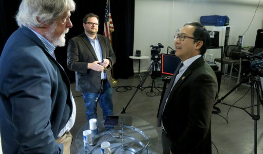 Asbury Park Press Editorial Page Editor Randy Bergmann (left) and reporter Mike Davis (center) speaks with US Congressman Andy Kim after he participated in a Facebook live show from the Press' Neptune studio Tuesday, April 16, 2019.