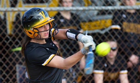 Alexis Agrapides hits a single, and makes it to third and then home on errors to put her team up 2-1 in the fifth inning. Middletown North Girls Softball vs St. John Vianney in Holmdel on April 16, 2019.
