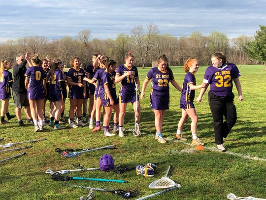 Goalie Allie Darcy (32) leads the handshake line after the Purple Roses defeated Trinity Hall, 12-10, on April 16, 2019 at the Dorbrook Recreation Area in Colts Neck