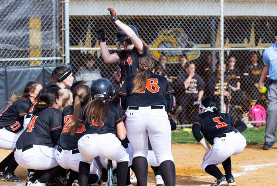 Middletown North's Malori Bell is greeted at the plate after hitting a home run which tied the game at 1-1 in the 4th. Middletown North Girls Softball vs St. John Vianney in Holmdel on April 16, 2019.