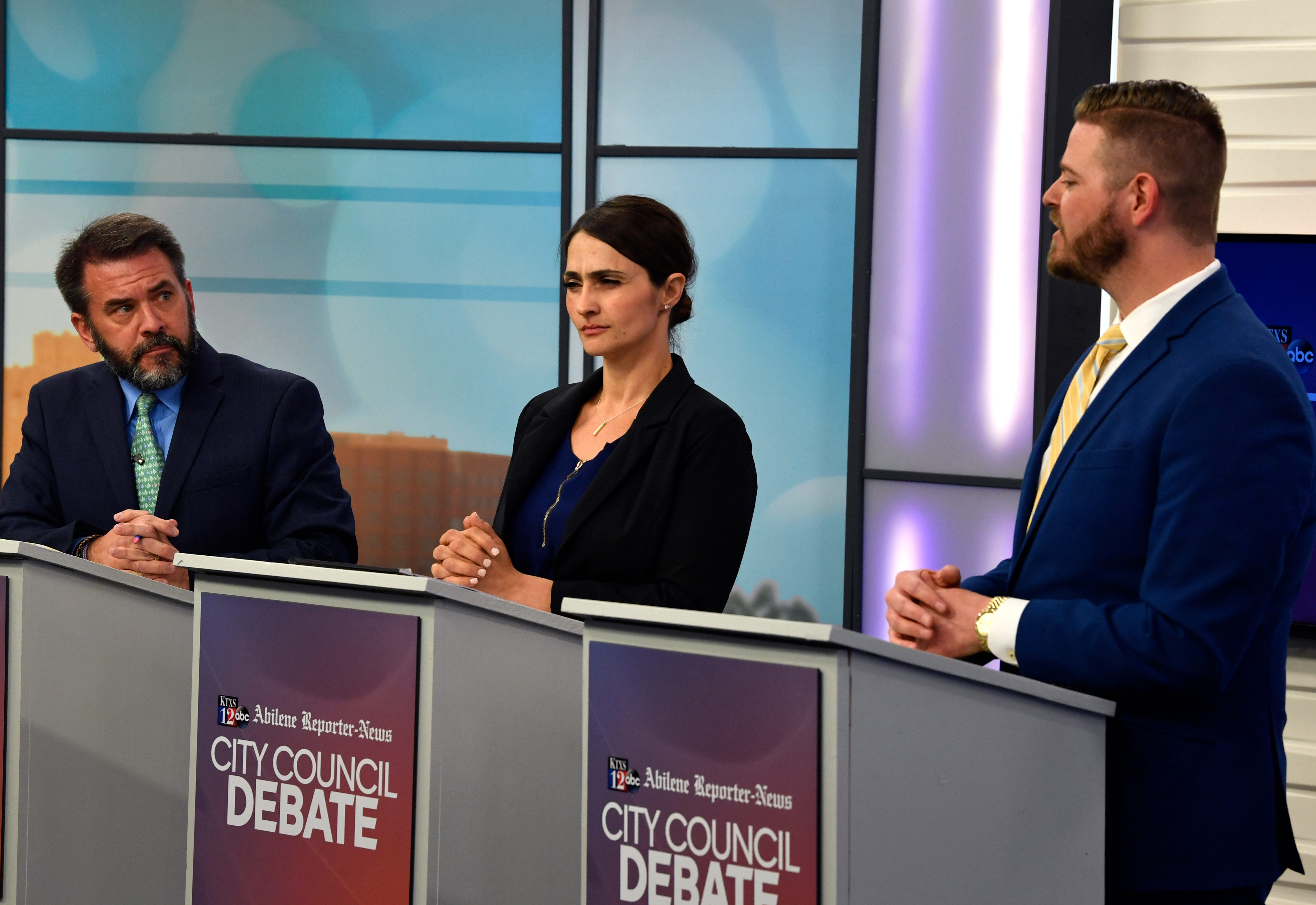 Incumbent Place 5 Abilene City Councilman Kyle McAlister (left) and challenger Cynthia Alvidrez listen as challenger Cory Clement explain his positions Monday April 15, 2019. The joint KTXS and Abilene Reporter-News debate aired Tuesday.