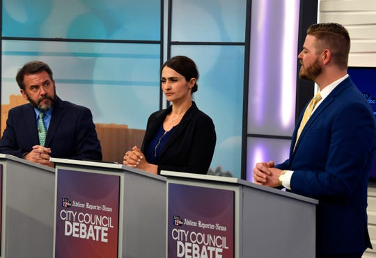 Incumbent Place 5 Abilene City Councilman Kyle McAlister (left) and challenger Cynthia Alvidrez listen as challenger Cory Clement explain his positions at joint Abilene Reporter-News-KTXS debate aired Tuesday.