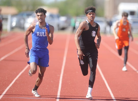 Loraine's Tony Williams, right, and Rule's Chase Thompson sprint toward the finish line during the 400-meter dash at the Districts 13/14-1A area track meet Monday, April 15, 2019, at Piper Stadium in Hamlin. Williams won the event in 50.74 seconds, a hundreth of a second ahead of Thompson.