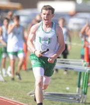 Hamlin's Jared Woods yells in excitement after finishing first in the 1,600 relay at the Districts 13/14-1A area track meet Monday, April 15, 2019, at Piper Stadium in Hamlin. The win clinched the team title for the Pied Pipers.