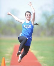 Rule's Leann Manske triple jumps at the District 13/14-1A area track meet Monday in Hamlin. Manske won the event with a leap of  35 feet, 6 inches.