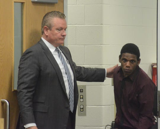 Davion Brown enters the courtroom with his attorney, Donald Sappanos.