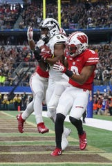 Western Michigan Broncos wide receiver Corey Davis (84) catches a touchdown pass in front of Wisconsin Badgers cornerback Sojourn Shelton (8) during the second half of the 2017 Cotton Bowl at AT&T Stadium.