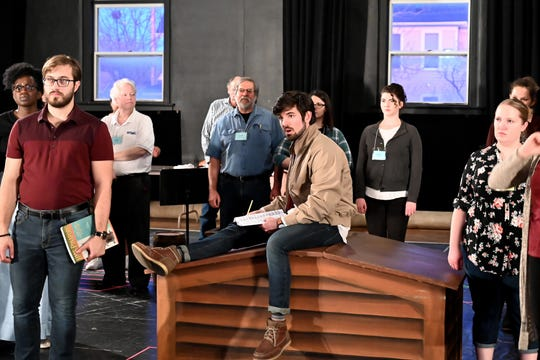 """Kevin Bryant, center, and the company of of Tri-Cities Opera's production of """"H.M.S. Pinafore"""" rehearse the operetta ahead of the April 28 production."""