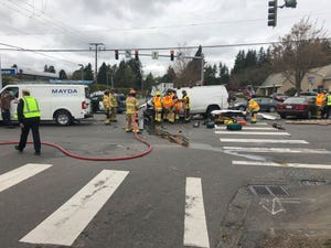 Firefighters respond to a crash at Highway 303 and Riddell in East Bremerton on Tuesday.