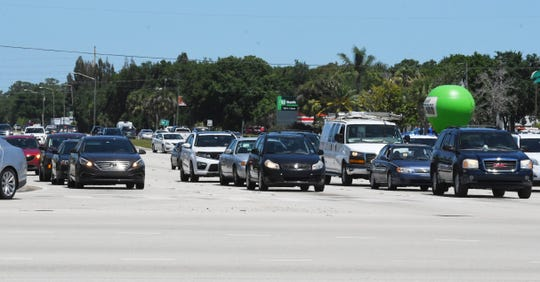 Stopped traffic stacks up on Babcock Street at the congested intersection of Palm Bay Road.