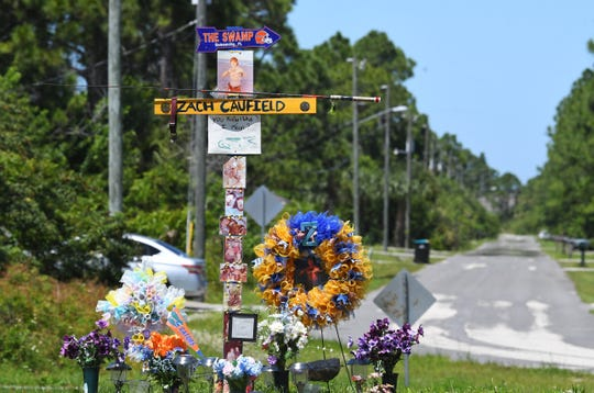 The temporary roadside memorial along Malabar Road in Palm Bay to their grandson  Zach Caufield, 19, who was killed at night in a crash where Hoffer Avenue ends at the Melbourne Tillman Canal system. Hoffer Ave. can be seen in the background.