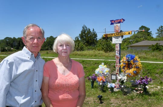 Frank and Jeannie Caufield of Satellite Beach, at the temporary roadside memorial along Malabar Road in Palm Bay to their grandson  Zach Caufield, 19, who was killed at night in a crash where Hoffer Avenue ends at the Melbourne Tillman Canal system.