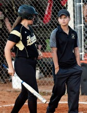 Viera softball coach Alex Breeden talks with a player during a game in Cocoa.