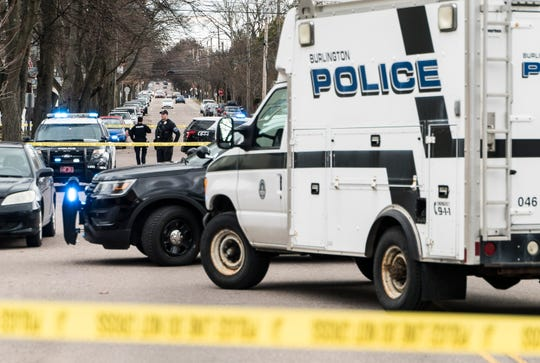 Burlington police investigate a shooting on North Willard Avenue on Tuesday afternoon, April 16, 2019. At least one person was seen outside a residence on the ground as emergency crews administered CPR before being taken to UVM Medical Center.