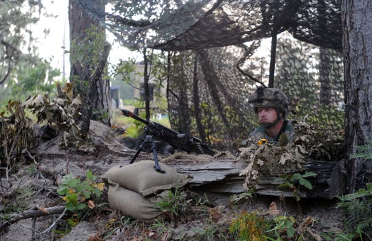 """A soldier from the Vermont National Guard's 3rd Battalion, 172nd Infantry Regiment (Mountain) stands guard behind an M2 .50-caliber Machine Gun during a """"Decisive Action Training Environment"""" rotation at Fort Polk, La., June 21, 2014. The 86th Infantry Brigade Combat Team (Mountain), parent unit of 3rd Battalion, is the only National Guard brigade to take part in a rotation here at the Joint Readiness Training Center in 2014"""