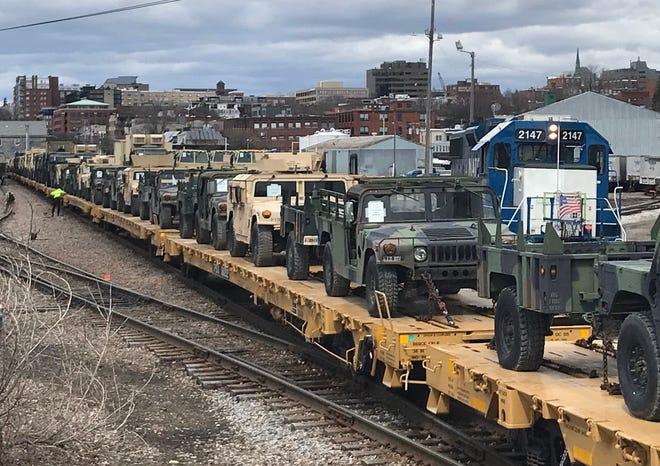Vermont Army National Guard vehicles line the Burlington rail yard on Tuesday, April 16, 2019.
