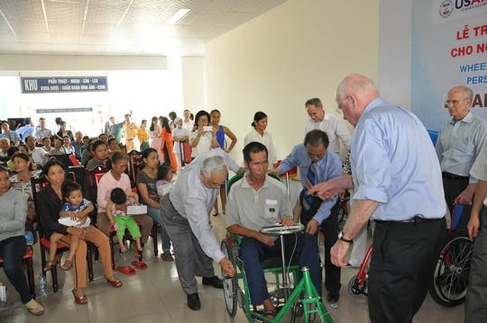 Sen. Patrick Leahy, D-Vt., right with back turned center, on a 2014  visit to the USAID-funded facility for Vietnamese citizens with disabilities, including illnesses caused by exposure to dioxin (Agent Orange).  Rep. Peter Welch, D-Vt., can be see on the far right. Leahy also is the leader in Congress on this project.