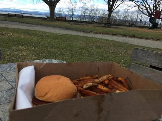 A bacon cheeseburger, order of fries and view of Lake Champlain courtesy of Beansie's Bus in Battery Park in Burlington on April 16, 2019.