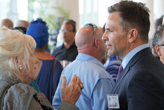 Peter Zanoni (right) — a finalist for the Corpus Christi city manager position — meets with attendees during an April 15 meet-and-greet event at the American Bank Center.