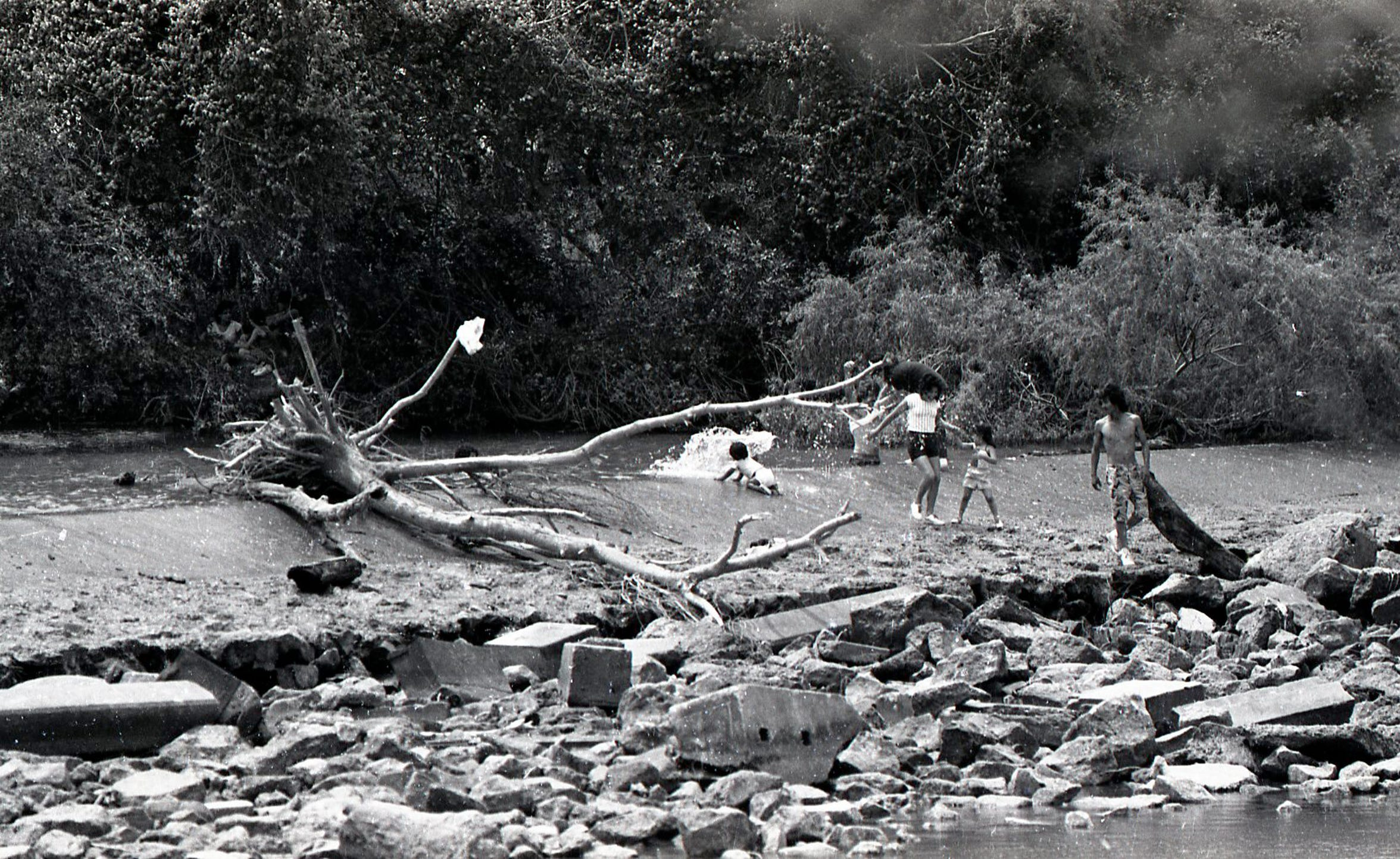 Swimmers cool off in the river at Nueces River Park in Corpus Christi on Easter Sunda, April 19, 1987.