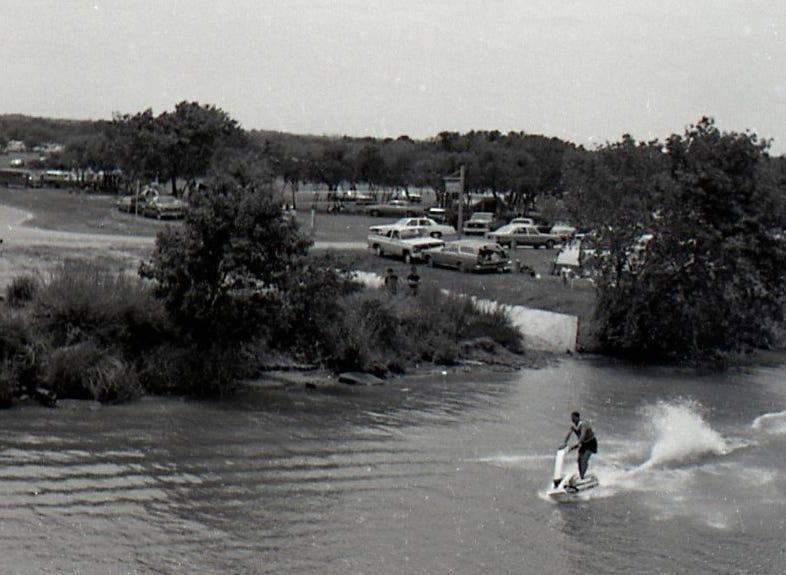 A jet skier cruises the river at Nueces River Park in Corpus Christi as people enjoy Easter Sunday on April 19, 1987.