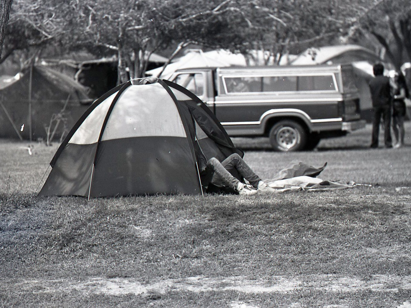 A camper rests in his tent at Nueces River Park in Corpus Christi on Easter Sunday, April 19, 1987.