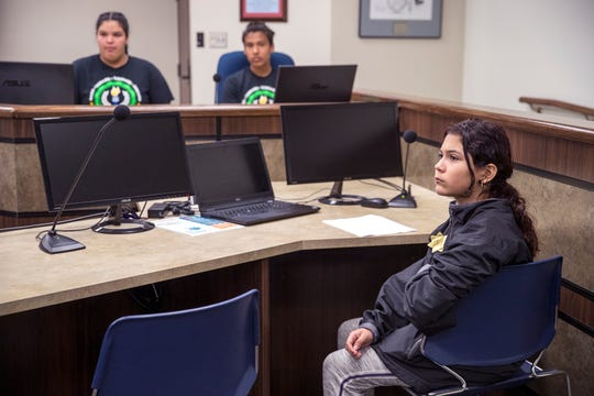 Haas Middle School student Alyssa Martinez, 12, acts as sheriff during a mock commissioners court meeting at the Nueces County Courthouse on Tuesday, April 16, 2019.