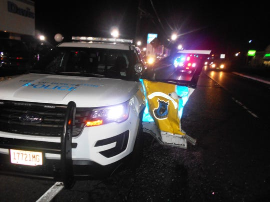 A Burlington Township police cruiser was struck by a passing car, narrowly missing a police officer as he was getting out of his vehicle during a car stop on Sunday, April 14, 2019.  The officer acted quickly to get out of the way and was not injured. The other vehicle remained on scene to assist with the investigation, and both occupants escaped injury as well.