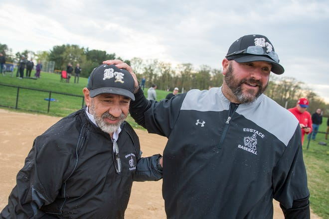 Bishop Eustace head coach Sam Tropiano, left, is congratulated by assistant coach Nick DelGozzo in 2019 after becoming South Jersey's all-time winningest baseball coach. He became the sixth coach in state history to reach 700 on Friday.
