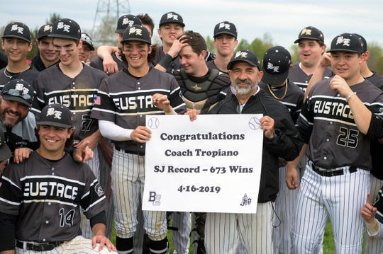 Bishop Eustace head coach Sam Tropiano, poses with his team following a 5-3 win over Lenape, earning his 673rd win and a new South Jersey record Tuesday, April 16, 2019 at Lenape High School in Medford, N.J.